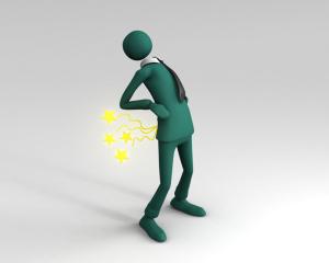 Unternehmer-mit-Rueckenschmerzen