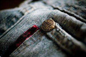 Closeup of copper rivet on jeans